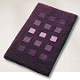 dense high pile contemporary rug with a geometric block pattern in eggplant, slate grey, dark blue or wine red
