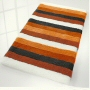 plush striped multi color bath rug in beige, orange, blue, black or green